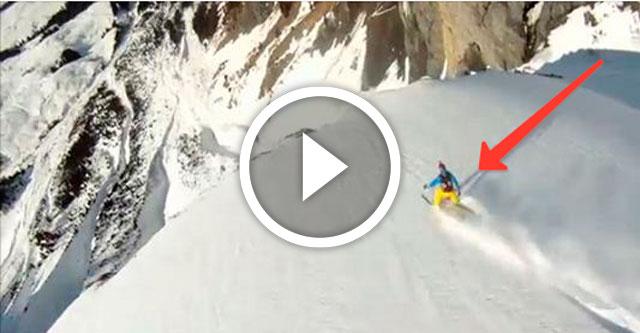 горнолыжник спасается от лавины