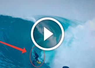 серфер на огромной волне